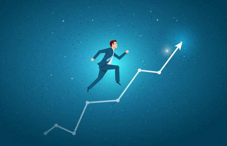 Business man climbing a graph line