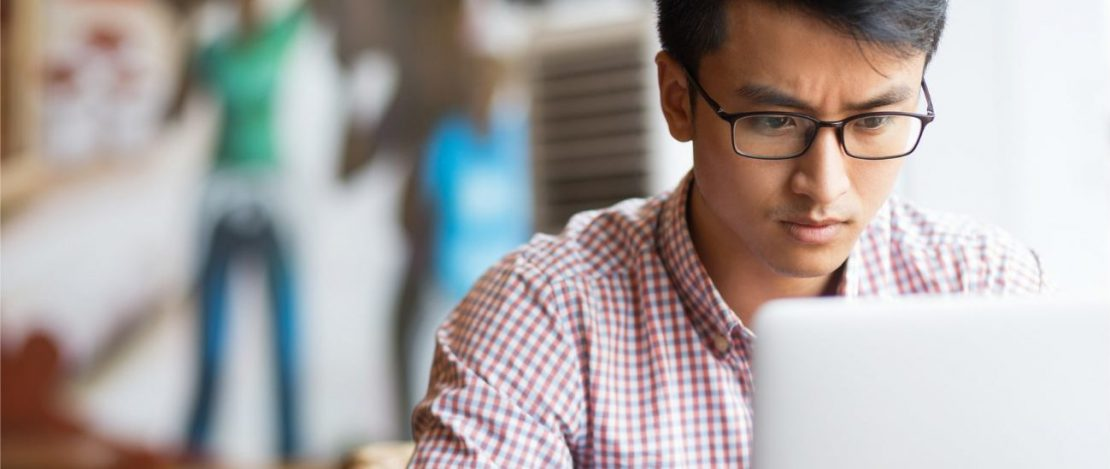 Online associates degree   man on computer