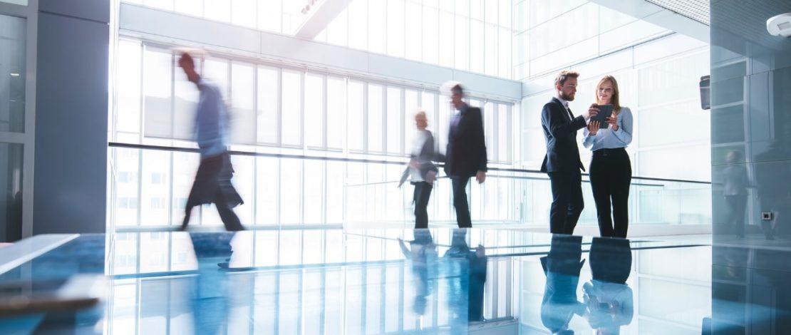 Online Business Degree   Professionals in Hallway