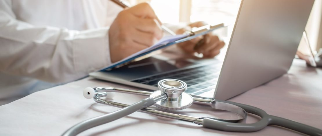 Health informatics bachelor degree online | Person working on laptop