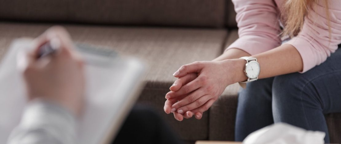 Psychology Degree Online | Person in therapy session